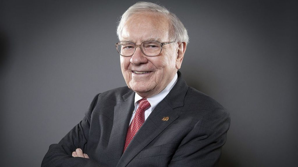 Warren Buffett in kenmerkende pose.